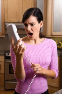 Woman Holding Phone in Disbelief