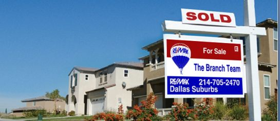 Sold Sign in Neighborhood